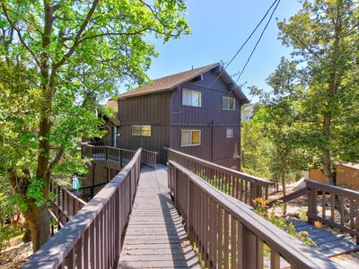 Photo for NEW LISTING! Peaceful house with large deck with lake views and private hot tub
