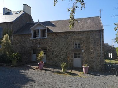Photo for Charming semi-detached stone house, close to the sea and golf