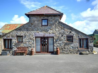 Photo for Three miles from Caernarfon on a working farm is a cottage converted from a former granary and calle
