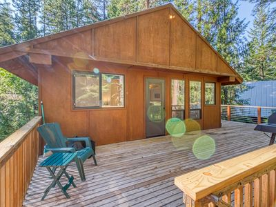 Photo for Dog-friendly woodland cabin w/ deck & private game room - walk to the river