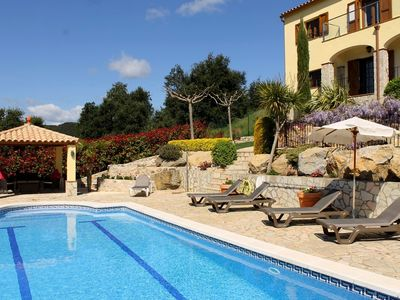 Photo for Hillside villa, magnificent views, heated private pool, short walk to village