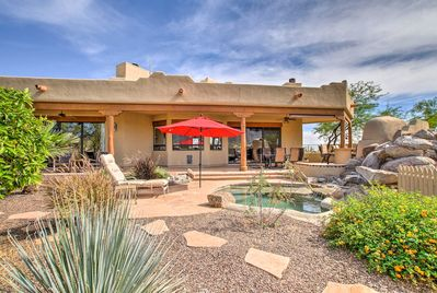 See the beauty of the desert at this vacation rental house in Cave Creek!