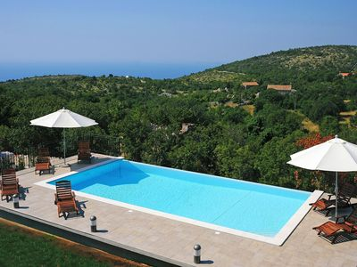 Photo for This 4-bedroom villa for up to 8 guests is located in Rabac and has a private swimming pool, air-con