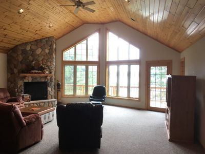 Front room with cathedral windows facing the lake