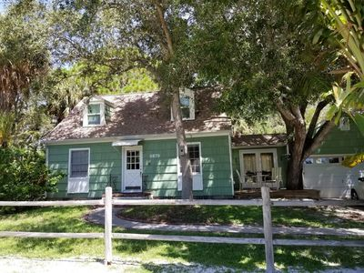Photo for 3 bedroom quaint cottage in Gulfport, Florida! Private yet close to town. Pet friendly!