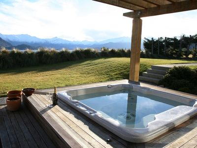 Photo for Mountain and lake views from the private hot tub, tennis court and large garden.