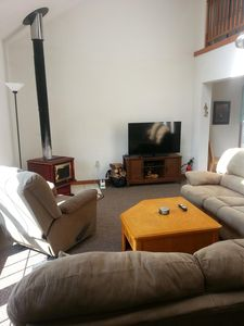 """living room with wooodstove, 50""""led tv"""