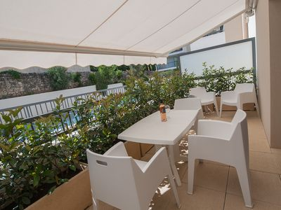 Photo for Studio with terrace, quiet, close to downtown, in residence with swimming pool