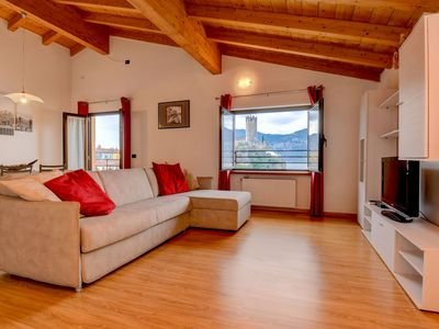 Photo for Modern Holiday Apartment with Wi-Fi, Air Conditioning, Pool, Lake View & Garden; Parking Available, Pets Allowed