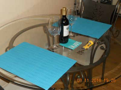 COMPLIMENTARY BOTTLE OF WINE ON DINING TABLE