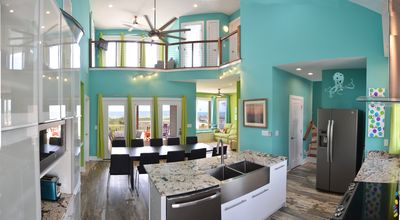 View from kitchen towards ocean - note  dining room, living room, and upstairs