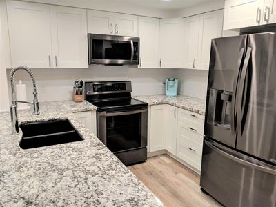 Photo for **BRAND NEW**  Professionally designed/decorated.  Walk to the beach!