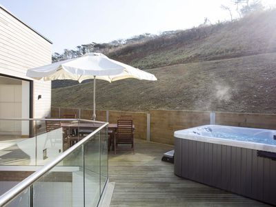Photo for Stunning 4 bedroom  beach house with hot tub and sunbathing roof terrace