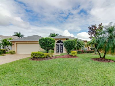 Photo for Enjoy a heated, private pool in this gated, watefront community - close to beach