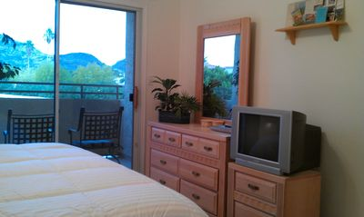 Mountain views and private balcony from the master bedroom.