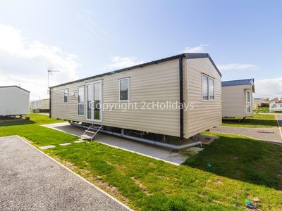 Photo for 6 berth caravan holiday home for hire with decking at St Osyth's Park ref 28025M