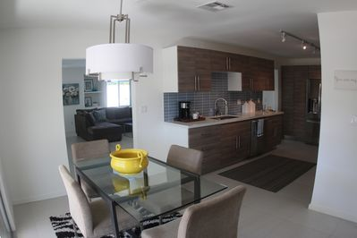 Kitchen is in the center of TWO living rooms and TWO dining areas..very open!