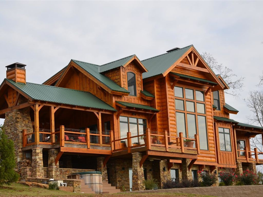 ozark mountain lodge with expansive lake and mountain 87722