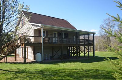 Large covered deck with gas grill