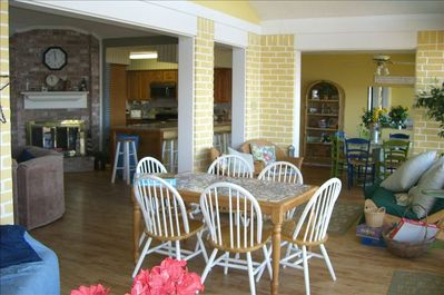 open and light rooms, taken from sunroom with extra table for games and dining