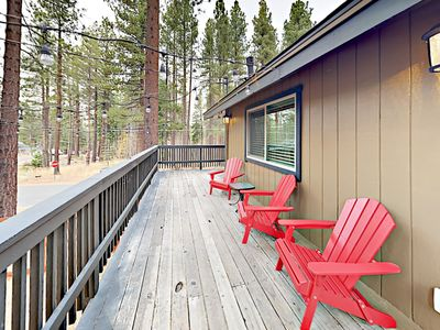 Deck - The wraparound deck is furnished with 6 Adirondack chairs.