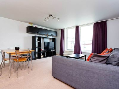 Photo for Two bedroom flat with balcony overlooking the River Thames, sleeps 6 (Veeve)