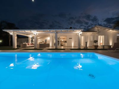 Photo for Boutique villa few steps from the beach, with amazing pool and garden.