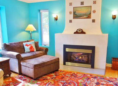 Cozy up to the fire at Blue Door Cottage
