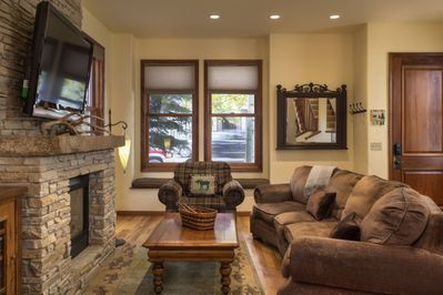 Cozy living room with gas fireplace and large flat screen tv