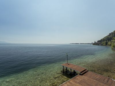 Photo for Newly renovated apartment directly on the lake, private pier, beach and lake