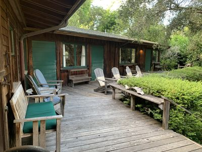 Enjoy relaxing on the large deck, which overlooks the expansive, private garden.