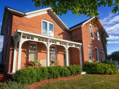 Photo for Charming Brick Farmhouse With A Touch Of Elegance. No extra cleaning fees!