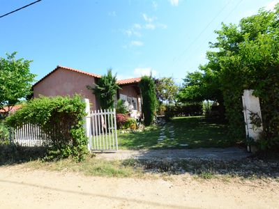 Photo for R147 Traditional house with beautiful yard.