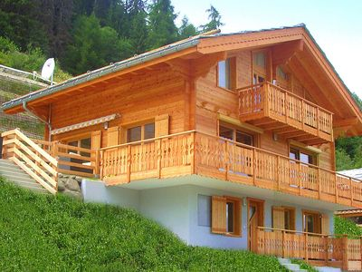 Photo for A luxurious 12 person chalet with superb view.