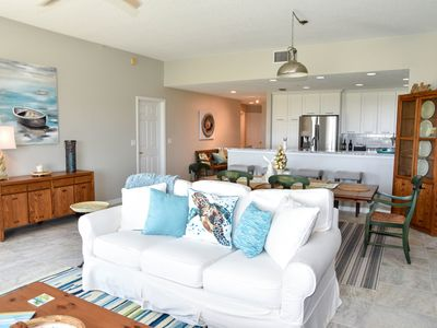Photo for Clean and newly updated spacious beach condo, steps from the ocean!