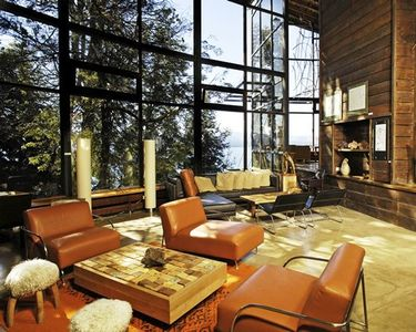 A well furnished indoor lounge area with an outside view.