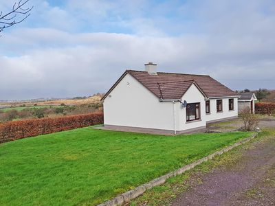 Photo for Detached bungalow with far reaching views over Rossbeigh Creek and Castlemaine Harbour to the…