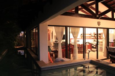 Picture of the villa, taken from your private pool, in the evening looking in.