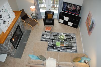 Great room with gas fireplace large flat screen tv, front deck, ceiling fan.