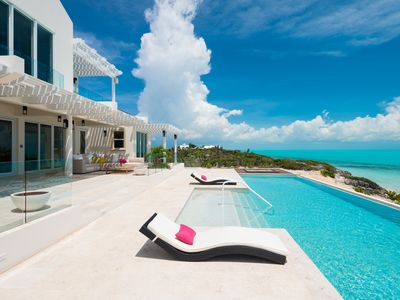 Photo for Luxurious Living on Long Bay Beach-Kayaks Heated Infinity Pool, Beachfront Deck
