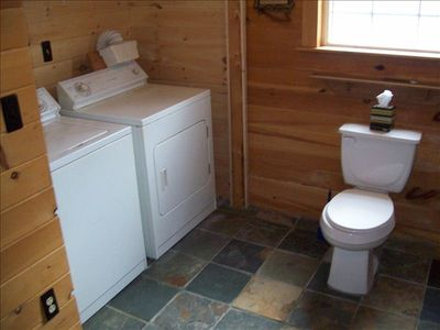 Totally modern bathroom with beautiful slate tile. Includes washer and dryer.