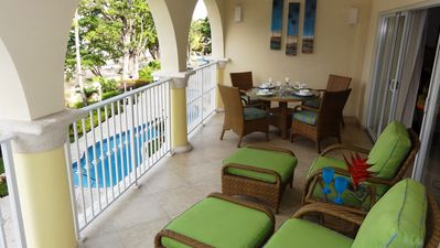 Relaxing loungers, dinning area patio with pool/seaside views.