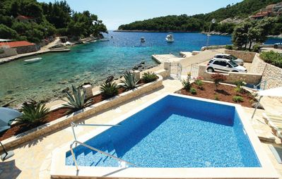 Photo for Croatia, Dalmatia, Korcula island, villa 8 people walking in the water and swimming pool