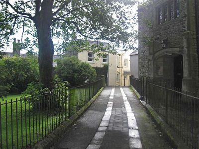 View of cottage from lane through All Saints Church