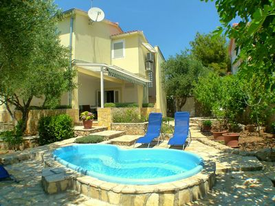 Photo for This 4-bedroom villa for up to 8 guests is located in Vodice and has a private swimming pool, air-co