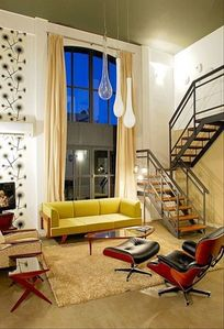 Floor to ceiling windows fill the apartment with light all day long