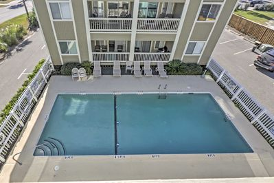 This vacation rental condo has access to a community pool.