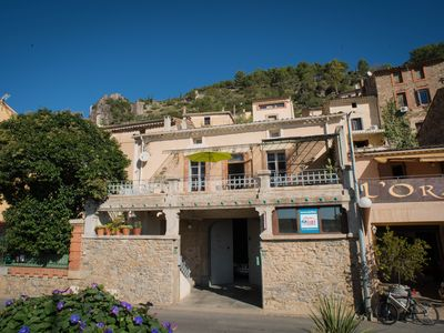 Photo for In the middle of Roquebrun, sunny terrace overlooking the river