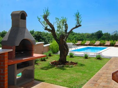 Photo for Stylish villa ***** with swimming pool and grill, bicycles, free WiFi