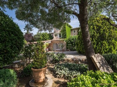 Photo for 18th C stone farmhouse with pool in charming Provençal village